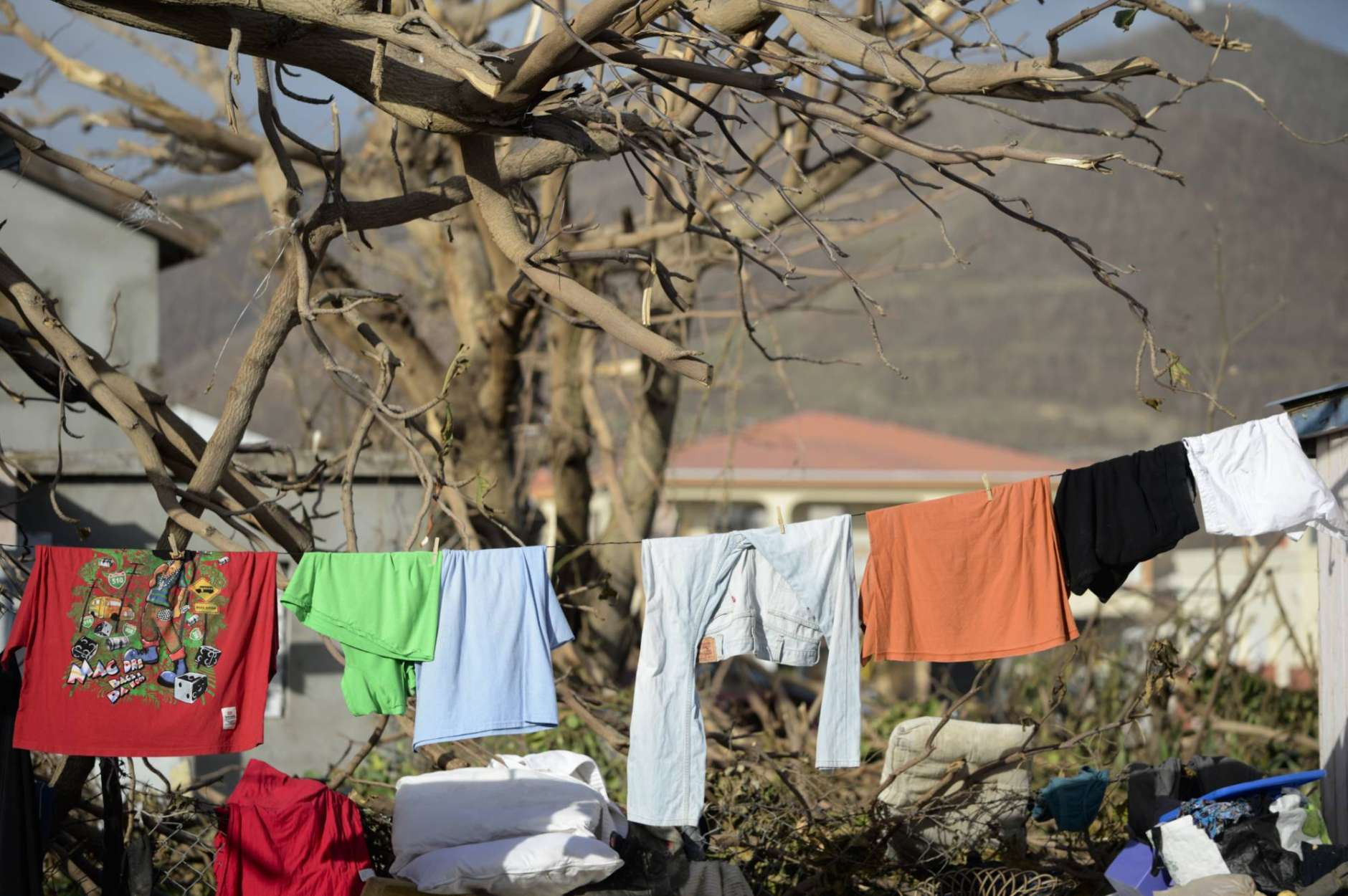 Residents hang clothes to dry after the passage of Hurricane Irma, in Phillipsburg, St. Martin, Monday, September 11, 2017. Irma cut a path of devastation across the northern Caribbean, leaving thousands homeless after destroying buildings and uprooting trees.  (AP Photo/Carlos Giusti)