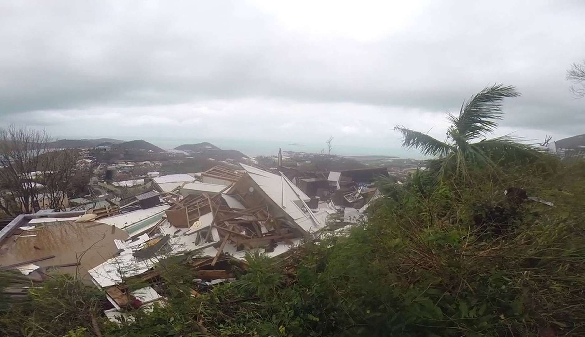 This image made from video shows several damaged houses by Hurricane Irma in St. Thomas, U.S. Virgin Islands, Thursday, Sept. 7, 2017. Hurricane Irma weakened slightly Thursday with sustained winds of 175 mph, according to the National Hurricane Center. The storm boasted 185 mph winds for a more than 24-hour period, making it the strongest storm ever recorded in the Atlantic Ocean. The storm was expected to arrive in Cuba by Friday. It could hit the Florida mainland by late Saturday, according to hurricane center models. (AP Photo/Ian Brown)