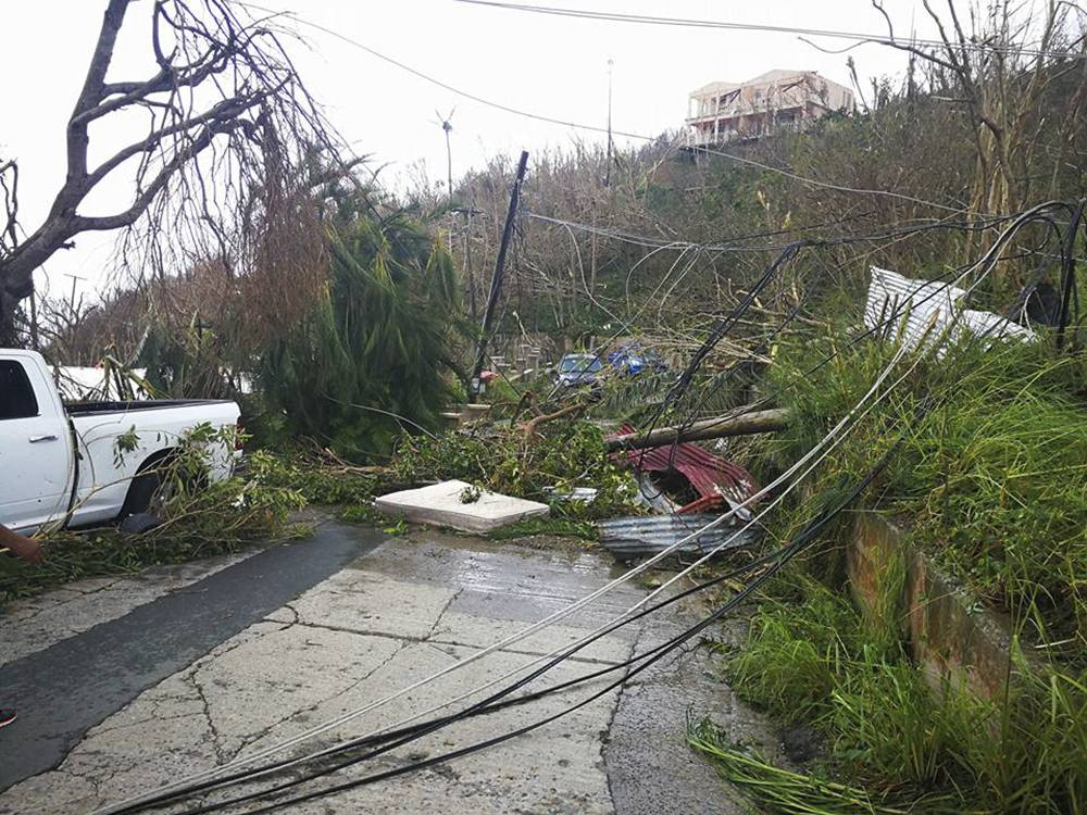 This Thursday, Sept. 8, 2017 photo shows storm damage in the aftermath of Hurricane Irma in Tortola, in the British Virgin Islands. Irma scraped Cuba's northern coast Friday on a course toward Florida, leaving in its wake a ravaged string of Caribbean resort islands strewn with splintered lumber, corrugated metal and broken concrete. (Jalon Manson Shortte via AP)