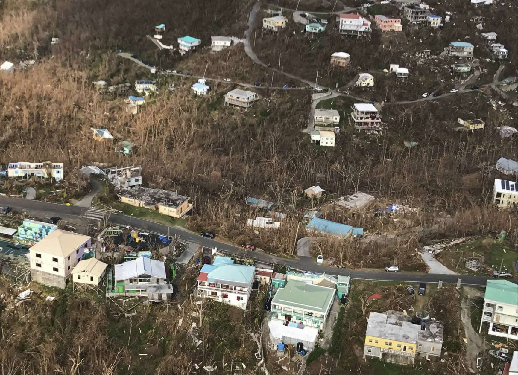 This photo provided by Caribbean Buzz Helicopters on Tuesday, Sept. 12, 2017, shows storm damage in the aftermath of Hurricane Irma in Cruz Bay, St. John, U.S. Virgin Islands. (Caribbean Buzz Helicopters via AP)