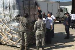 Virginia Task Force 1 members work with airmen from Robins Air Force Base in Georgia to finalize pallet loads of supplies for potential air transport to the Virgin Islands assignment. (Courtesy Fairfax County Fire Department)