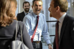 MCLEAN, VA - SEPTEMBER 19: Lt. Gov. Ralph Northam, center, runs into modertator Chuck Todd, right, during his walk-through before tonight's Gubernatorial debate between himself and Republican candidate Ed Gillespie, on September, 19, 2017 in McLean, VA. (Pool Photo by Bill O'Leary/The Washington Post)