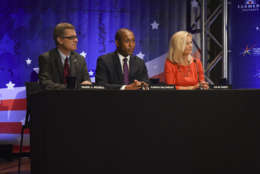 MCLEAN, VA - SEPTEMBER 19: The panel for tonight's gubernatorial debate between Republican candidate Ed Gillespie, and Lt. Gov. Ralph Northam, Democrat, on September, 19, 2017 in McLean, VA. From left are Mark J. Rozell, Aaron Gilchrist, and Julie Carey. (Pool Photo by Bill O'Leary/The Washington Post)
