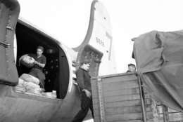 Last air-lift plane with the mascot number 7 on its hardstern being loaded with 10 tons of coal during the ceremony at Frankfurt's Rhein/Main Air Base in Frankfurt, Germany, Sept. 30, 1949. (AP Photo/Riethausen)
