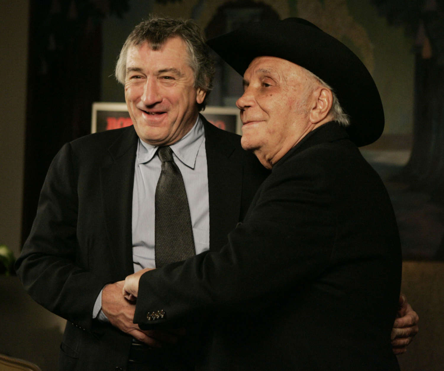 Robert DeNiro, left, and boxer Jake LaMotta stand for photographers before watching a 25th anniversary screening of the movie Thursday, Jan. 27, 2005 in New York. An anniversary collector's edition DVD of the film was also released.  (AP Photo/Julie Jacobson)