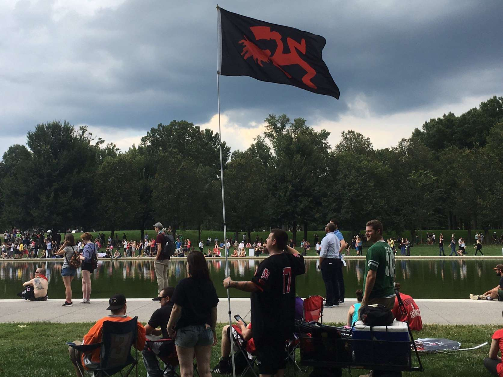 An ICP fan flies a flag with the band's logo at the Juggalo March Sept. 16, 2017. (WTOP/Mike Murillo)