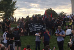 Members of an AntiFa  group (toting a profanity-laced flag that WTOP has censored) gathered on the Lincoln Memorial for  the Juggalo March Sept. 16, 2017. (WTOP/Mike Murillo)