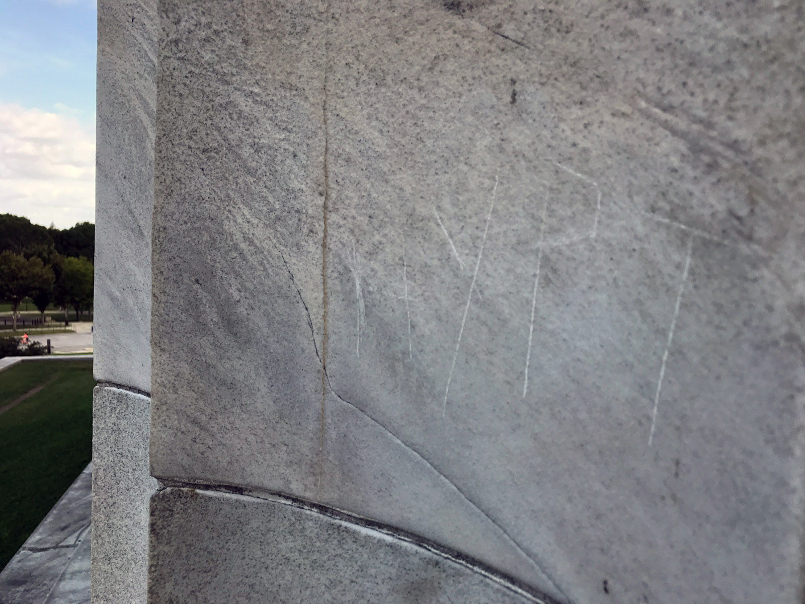 """The letters """"HYPT"""" are seen carved into the side of the Lincoln Memorial Tuesday. A man from the Kyrgyz Republic was arrested Monday on charges of defacing the Lincoln Memorial. National Park  officials said the penny he used to etch letters into a stone pillar caused permanent damage. (WTOP/Megan Cloherty)"""