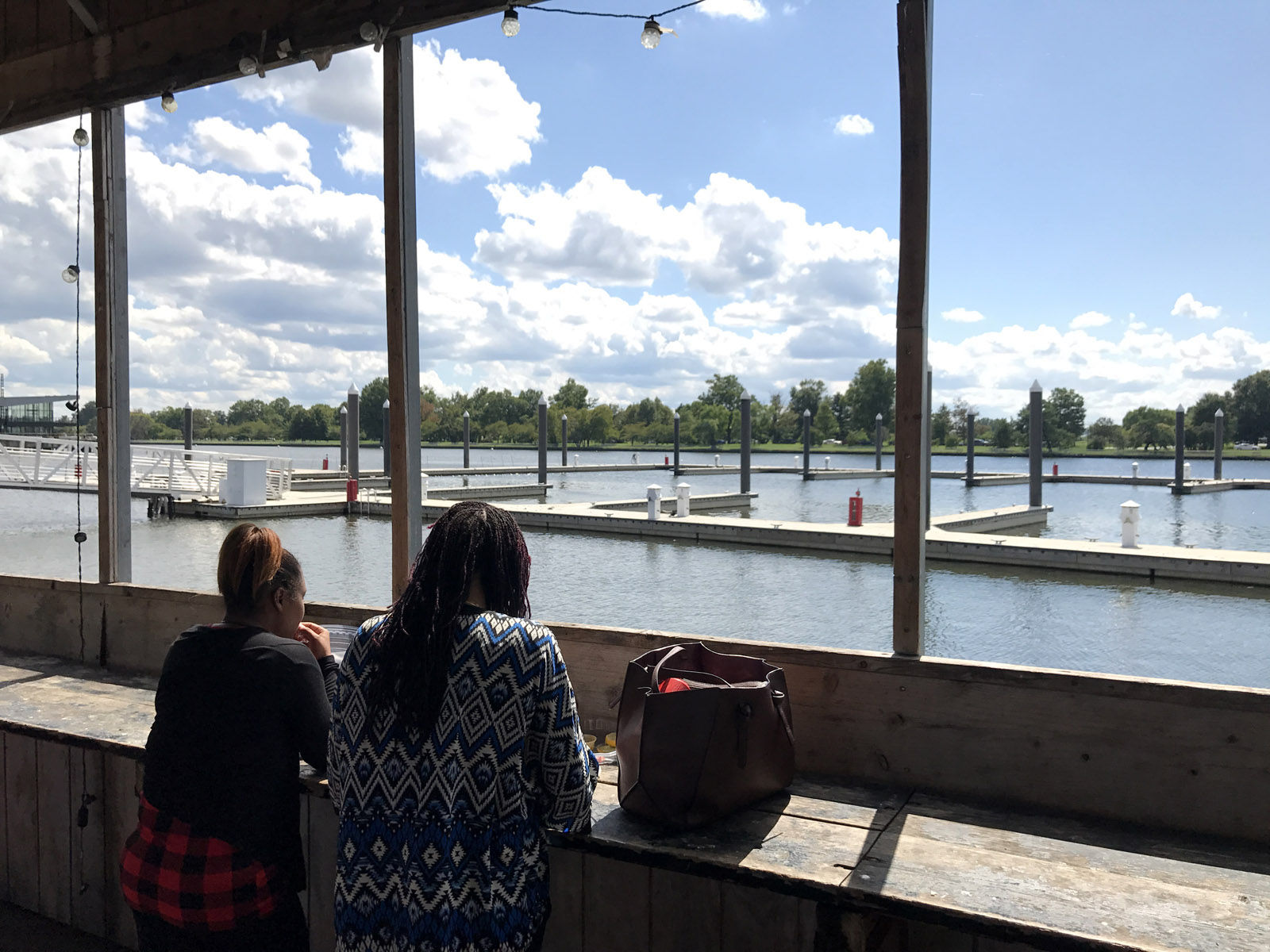 From the eating area set aside for customers of Captain White's, you can see the marina slips available for recreational boaters near the Maine Avenue Fish Market in this Sept. 7, 2017 photo. Improvements to the market are expected to wrap up sometime next spring. (WTOP/Michelle Basch)