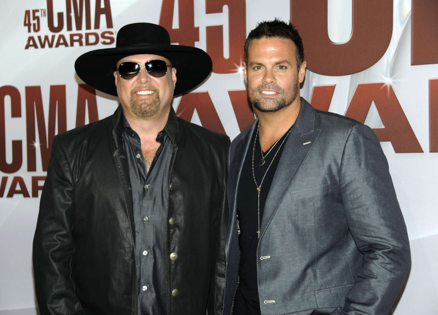 Eddie Montgomery, left, and Troy Gentry of Montgomery Gentry arrive at the 45th Annual CMA Awards in Nashville on Wednesday, Nov. 9, 2011. (AP Photo/Evan Agostini)