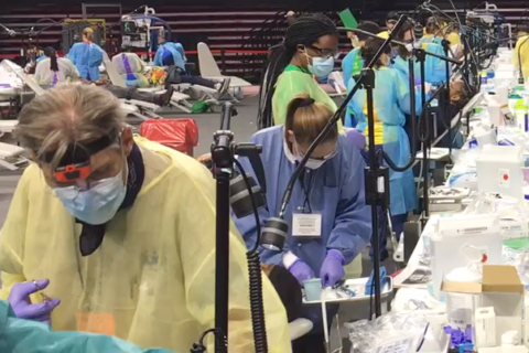 Inside arena, dentists and hygienists serve a Mission of Mercy