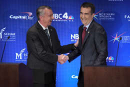 WASHINGTON , DC - SEPTEMBER 19: Gubernatorial candidates Ed Gillespie and Lt. Gov. Ralph Northam shake hands at the end of their debate in Washington, DC on September 19, 2017. (Pool Photo by Bonnie Jo Mount/The Washington Post)