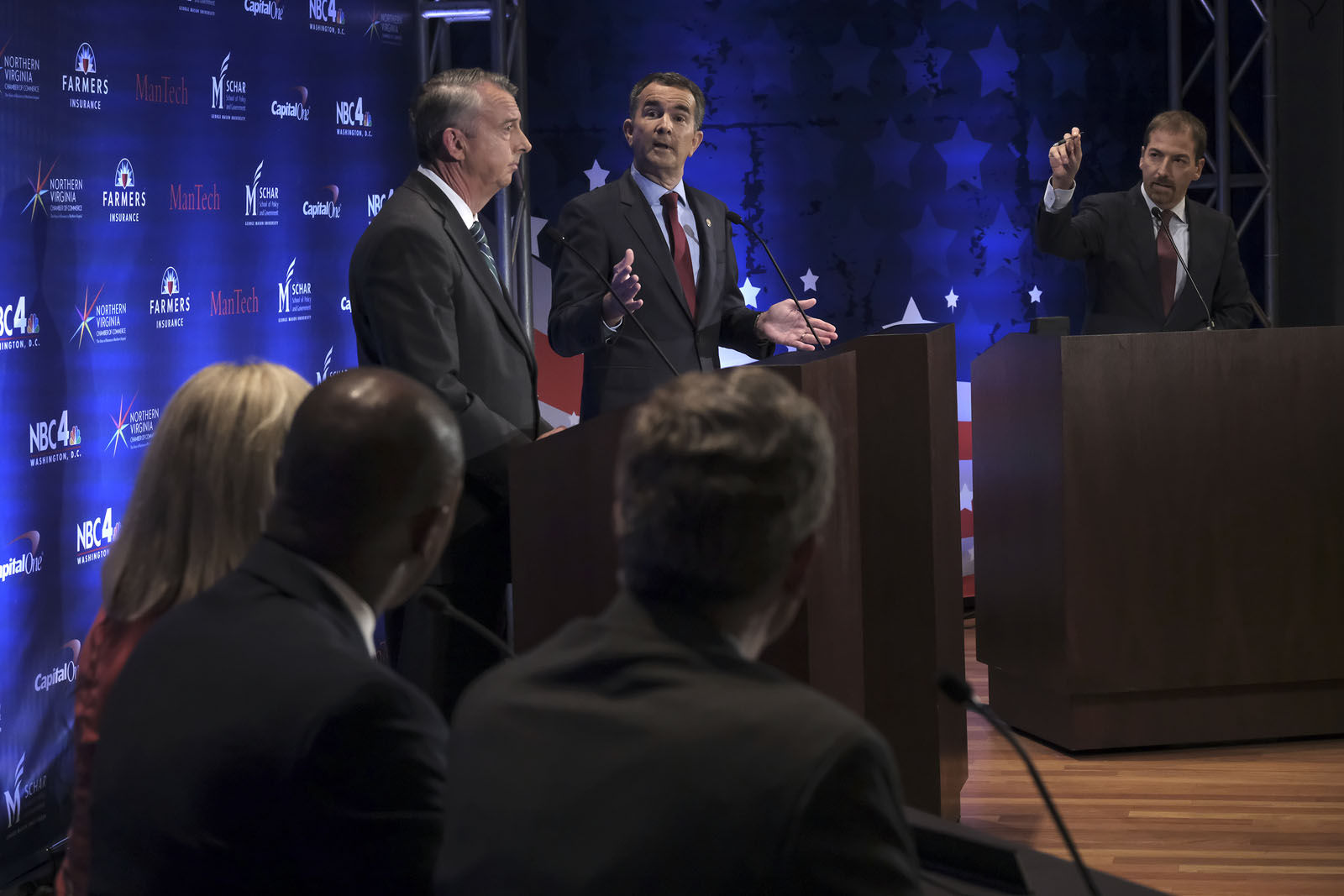 WASHINGTON , DC - SEPTEMBER 19: Moderator Chuck Todd, right, motions for time during the gubernatorial debate between Ed Gillespie, left, and Lt. Gov. Ralph Northam in Washington, DC on September 19, 2017. (Pool Photo by Bonnie Jo Mount/The Washington Post)