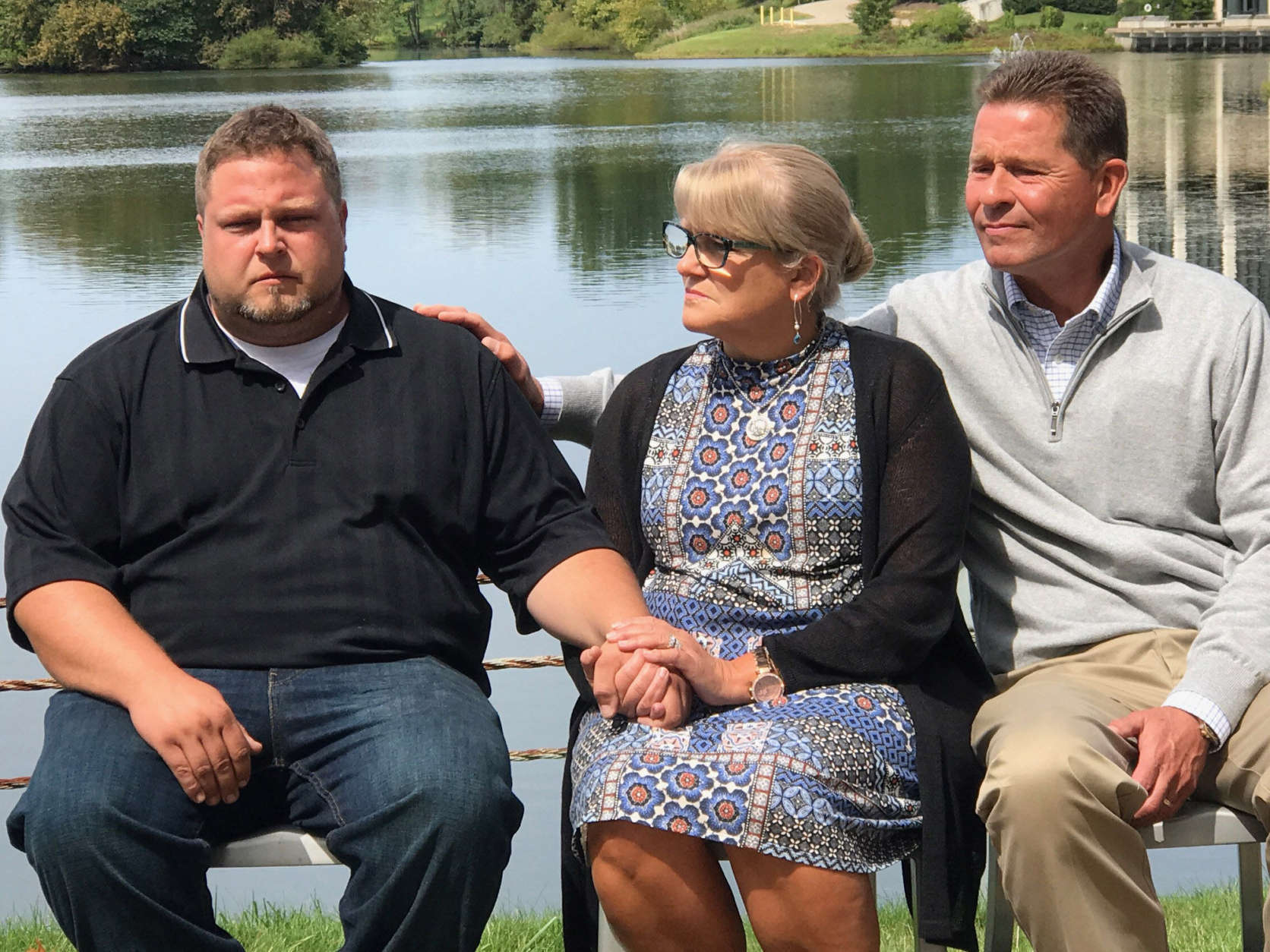 Tyler Tessier sits with Gwen and Mark Wallen during a press conference On Sept. 11, 2017 to ask for information regarding the whereabouts of Laura Wallen. The 31-year-old is four months pregnant and has been missing for more than a week. (WTOP/Megan Cloherty)