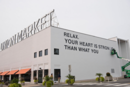 Union Market partners with Hirshhorn to present a public art mural by artist Yoko Ono - the current image is the installation in progress. (Emma McAlary)