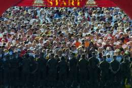 A line of Marines hold 27,822 runners at the starting line of the 30th Marine Corps Marathon on Sunday, Oct. 30, 2005, in Arlington, Va. (AP Photo/Kevin Wolf)