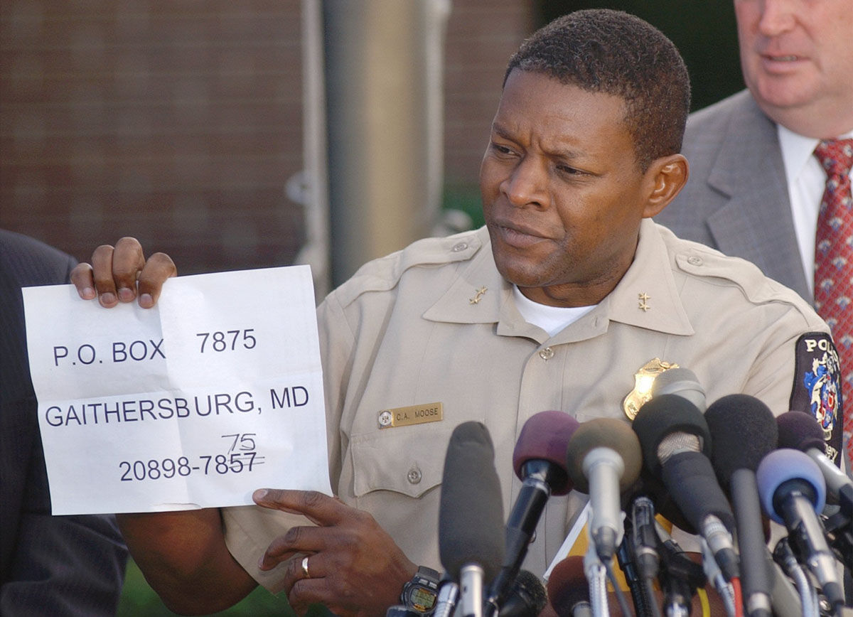 Montgomery County police chief Charles Moose holds a paper with a corrected address for the public to send tips  on the sniper shootings in the Washington D.C. area, during a news briefing at Montgomery County police headquarters in Rockville, Md., Monday, Oct. 14, 2002. (AP Photo/Don Wright)