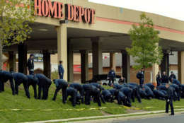 Fairfax County, Va. Police search for clues in a sniper shooting outside a Home Depot in Falls Church, Va. Tuesday, Oct. 15, 2002. Ballistics evidence links the death of a woman shot in a suburban parking lot to the Washington-area sniper, and authorities said Tuesday they were confident that detailed witness accounts from the scene would lead them to the person who has now killed nine people.  (AP Photo/Doug Mills)