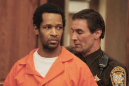 Sniper suspect John Allen Muhammad is led into a Prince William County courtroom in Manassas, Va., Friday, Feb. 14, 2003, for a motions hearing. At the hearing, Judge LeRoy Millette said defense attorneys for Muhammad will be given a videotape of a reported confession alleged accomplice Lee Boyd Malvo made to police. Muhammad, 42, and Malvo have been accused of shooting 19 people, killing 13 and wounding six in Alabama, Georgia, Louisiana, Maryland, Virginia and Washington, D.C. (AP Photo/Mike Morones,Pool)