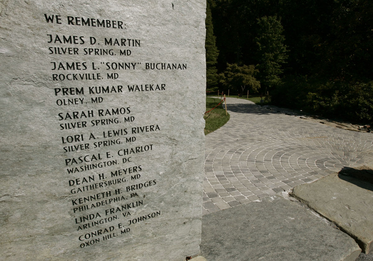 Names of the 10 people killed in the Washington area sniper shootings are etched into a stone in the Montgomery County arboretum in Wheaton, Md., Thursday, Sept. 23, 2004. The section of the arboretum will get a new name _ Reflection Terrace in memorial for the 10 people killed in the Washington area sniper shootings in 2002. The memorial will be officially dedicated Friday. (AP Photo/Chris Gardner)