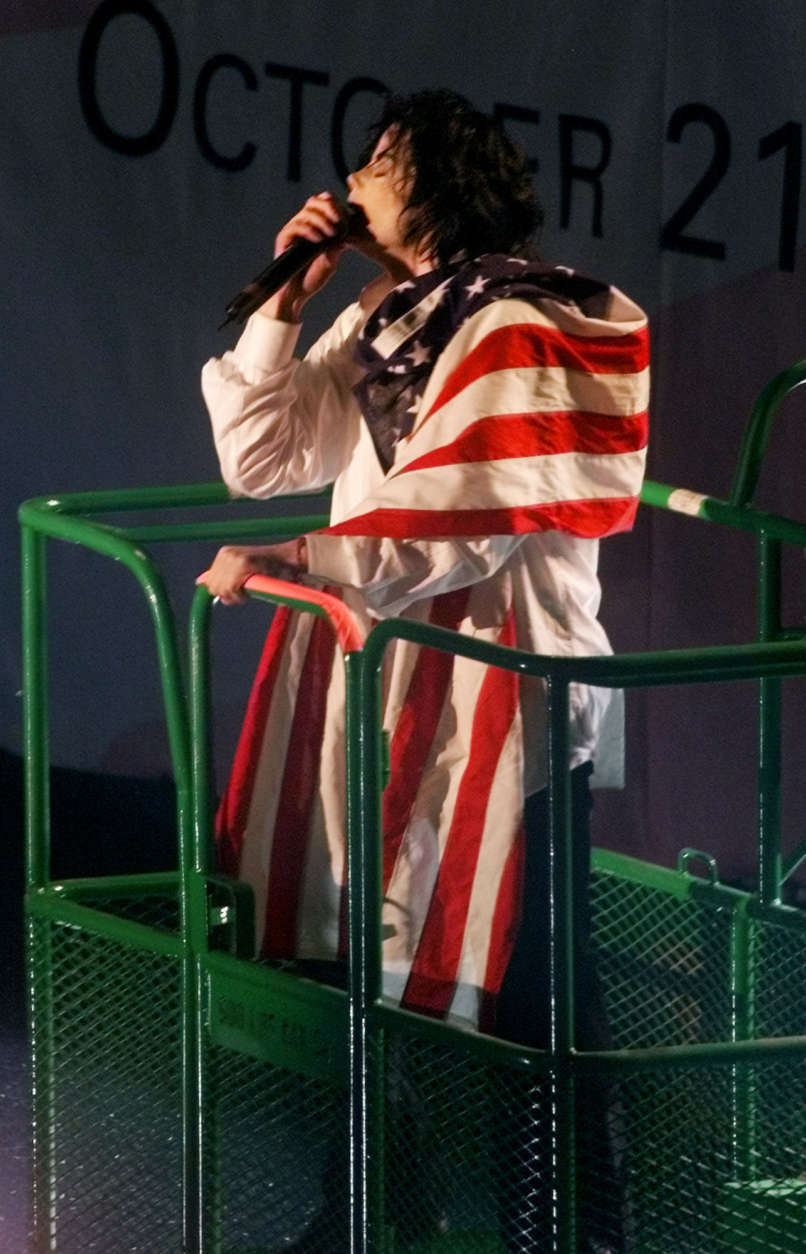 "Michael Jackson rides in a hydraulic lift as he performs during ""United We Stand: What More Can I Give?"" benefit concert Sunday, Oct. 21, 2001, at RFK Stadium in Washington. Tens of thousands of music fans gathered Sunday to see an array of pop stars at the marathon concert celebrating America and raising money for victims of September's terrorist attacks. (AP Photo/Pablo Martinez Monsivais)"