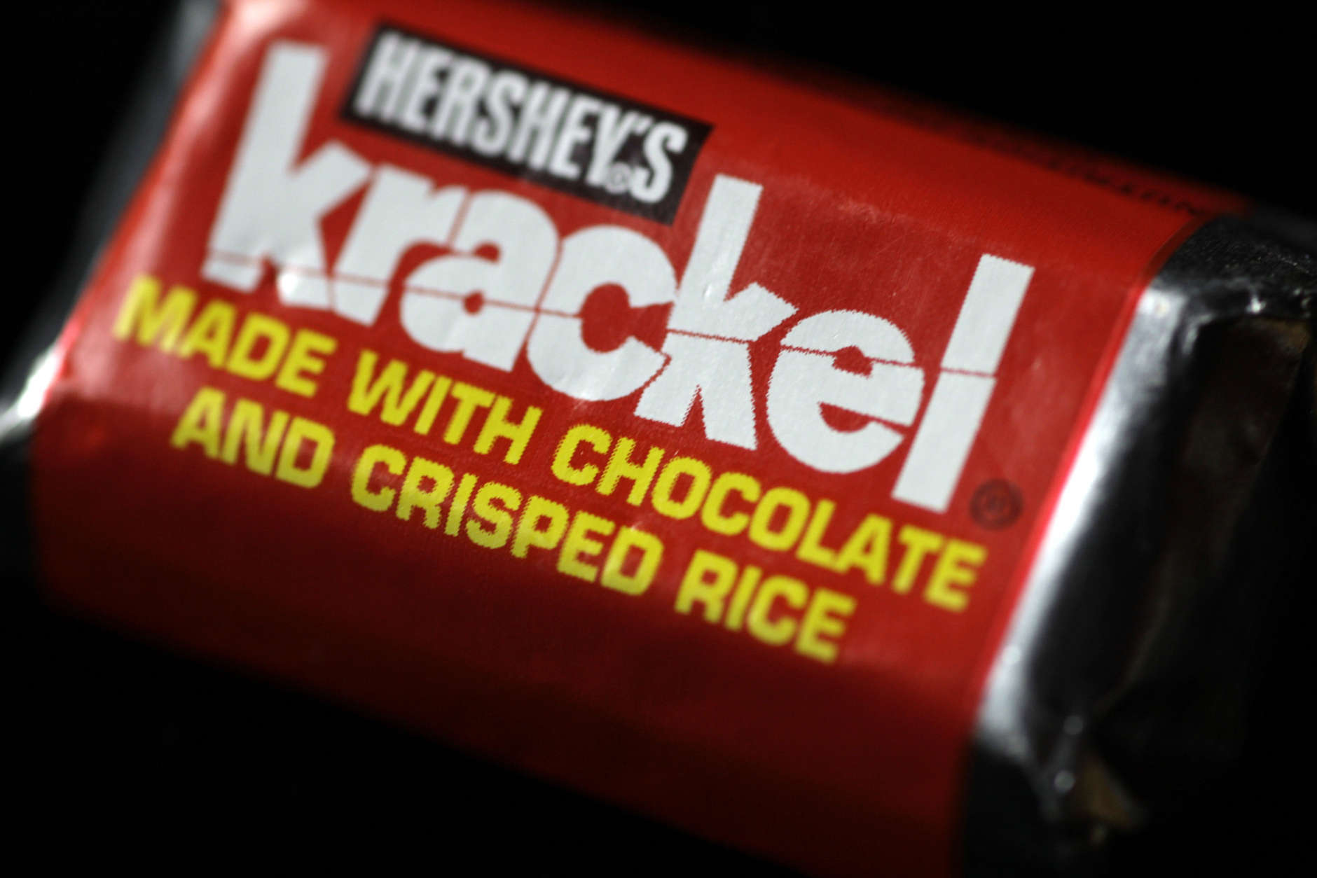 "Hershey's Krackel candy bar is photographed in Harrisburg, Pa., on Tuesday, Sept. 30, 2008.  Krackel is one of Hershey's candy products that contains a substitute that replaces some or all of the cocoa butter, a key ingredient in chocolate. While Hershey insists that consumer focus groups like the new flavor of the products, some critics say Hershey is sacrificing flavor in order to offset the rising cost of cocoa beans. Because of federal food standards, products that contain a substitute cannot be called ""chocolate."" Instead, Hershey must use words like ""chocolatey"" or ""made with chocolate"" on the packaging.(AP Photo/Carolyn Kaster)"