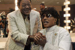 Fats Domino visits with Little Richard in a dressing room after Richards' performance at The Domino Effect, a tribute concert for Domino, at the New Orleans Arena in New Orleans, Saturday, May 30, 2009. A portion of the proceeds from the concert will go to New Orleans Saints quarterback Drew Brees' charitable foundation, the Brees Dream Foundation, which aims to improve local playgrounds and recreation sites in New Orleans. (AP Photo/Patrick Semansky)