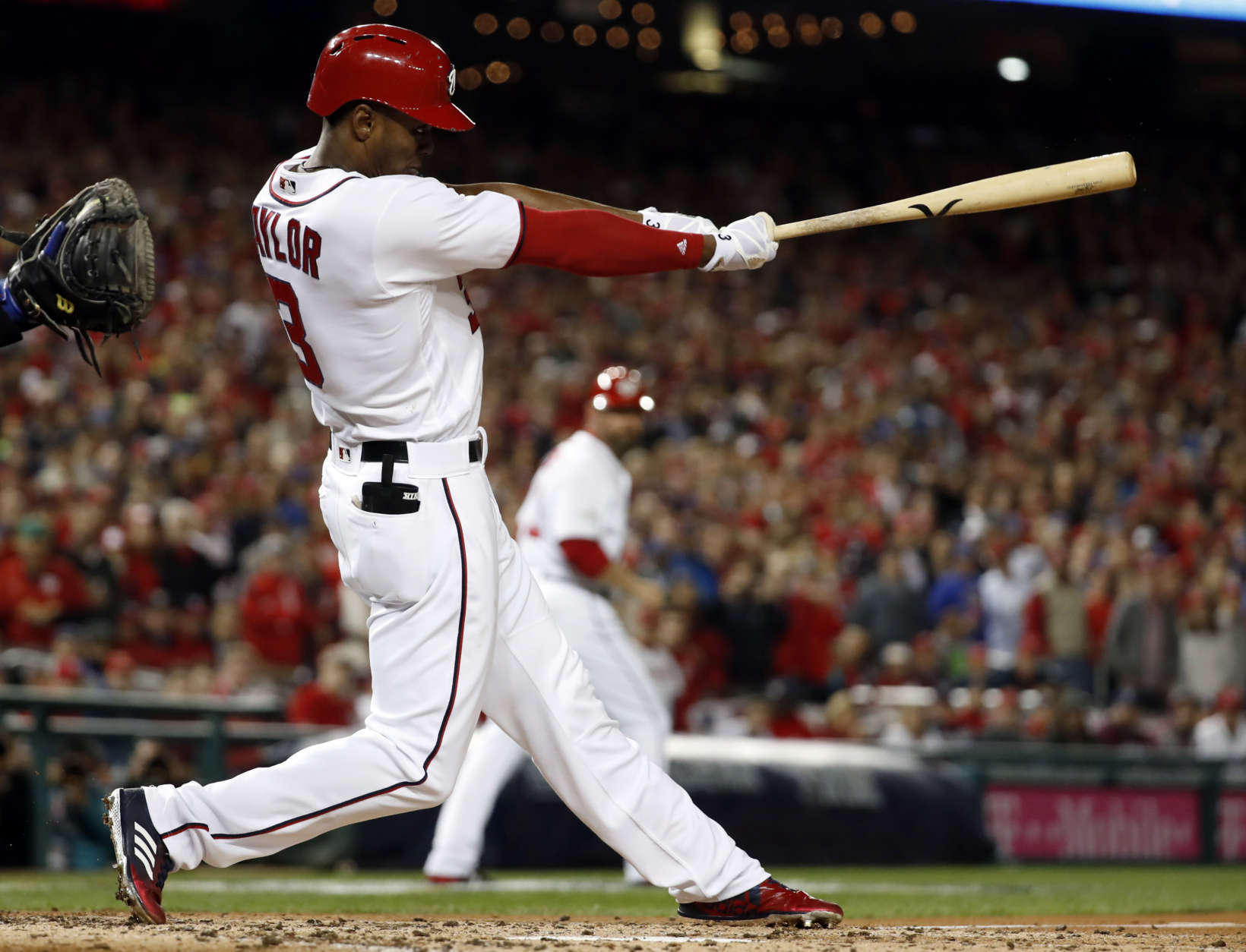 Washington Nationals' Michael A. Taylor (3) bats during Game 5 of baseball's National League Division Series against the Chicago Cubs, at Nationals Park, Thursday, Oct. 12, 2017, in Washington.. (AP Photo/Alex Brandon)