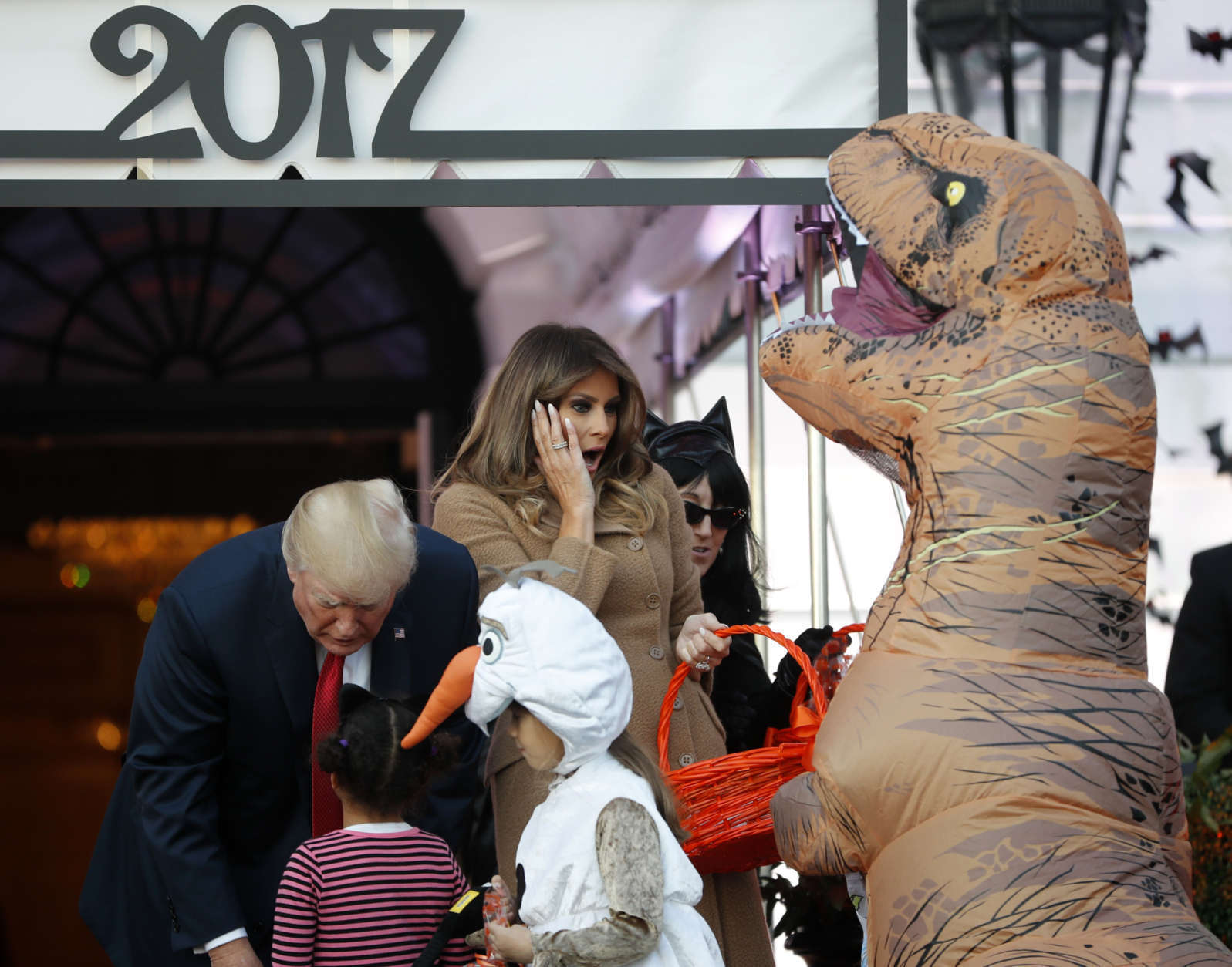 President Donald Trump and first lady Melania Trump hand out treats as they welcome children from the Washington area and children of military families to trick-or-treat celebrating Halloween at the South Lawn of the White House in Washington, Monday, Oct. 30, 2017. (AP Photo/Pablo Martinez Monsivais)