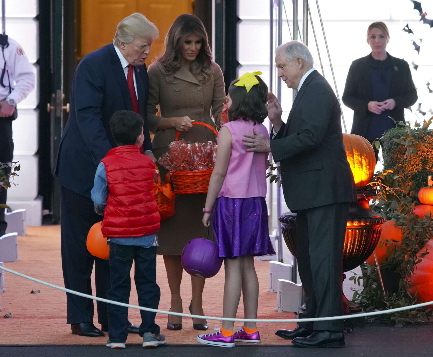 President Donald Trump and first lady Melania Trump meet Attorney General Jeff Sessions' grandchildren as Trump welcomes children from the Washington area and children of military families to trick-or-treat celebrating Halloween at the South Lawn of the White House in Washington, Monday, Oct. 30, 2017. (AP Photo/Pablo Martinez Monsivais)