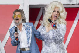 "Savannah Guthrie, left, and Matt Lauer dress as Kenny Rogers and Dolly Parton during NBC's ""Today"" show Halloween special at Rockefeller Plaza on Tuesday, Oct. 31, 2017, in New York. (Photo by Charles Sykes/Invision/AP)"