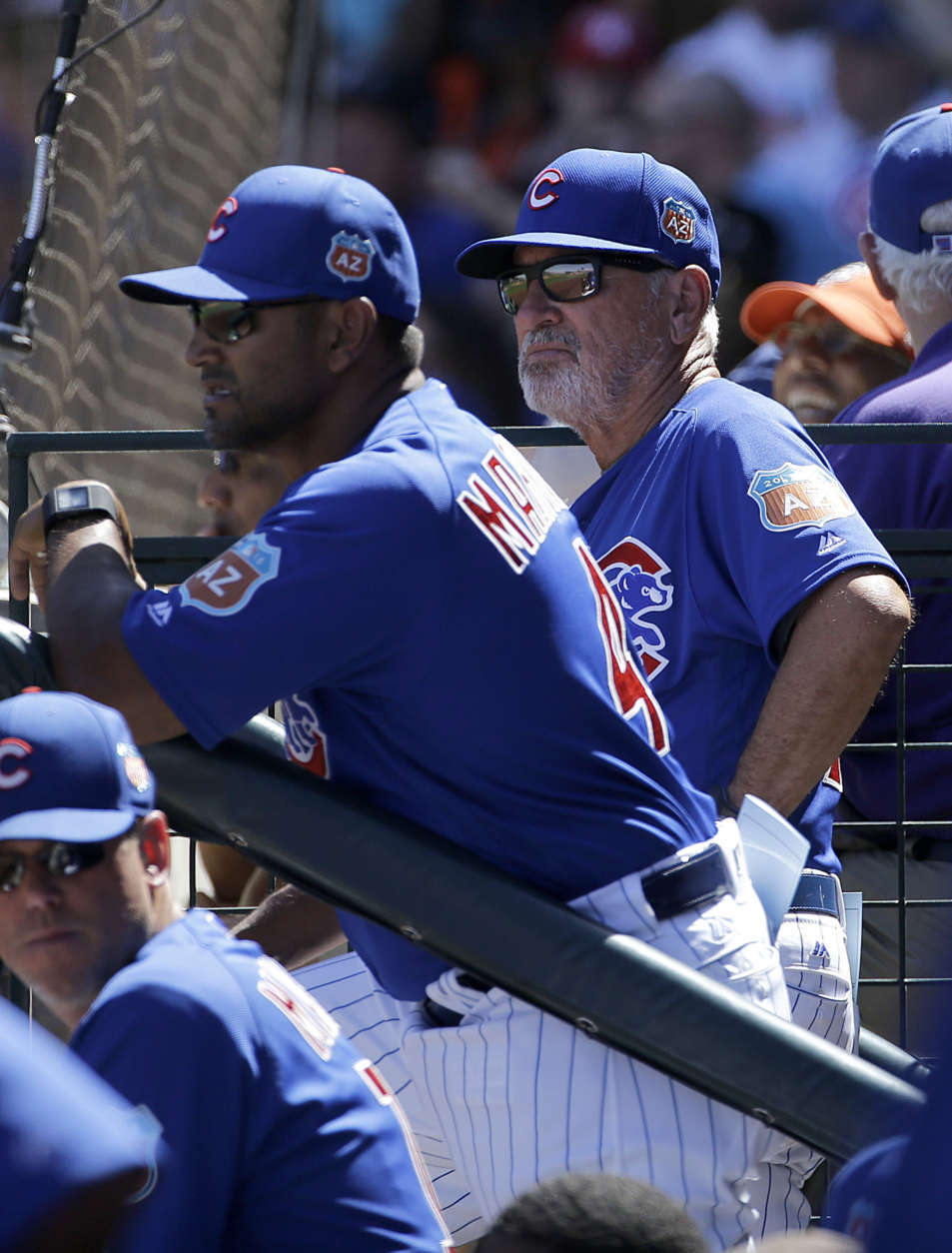 Chicago Cubs bench coach Dave Martinez, left, and manager Joe Maddon watch during a spring training baseball game between the Cubs and the San Francisco Giants in Mesa, Ariz., Saturday, March 26, 2016. (AP Photo/Jeff Chiu)