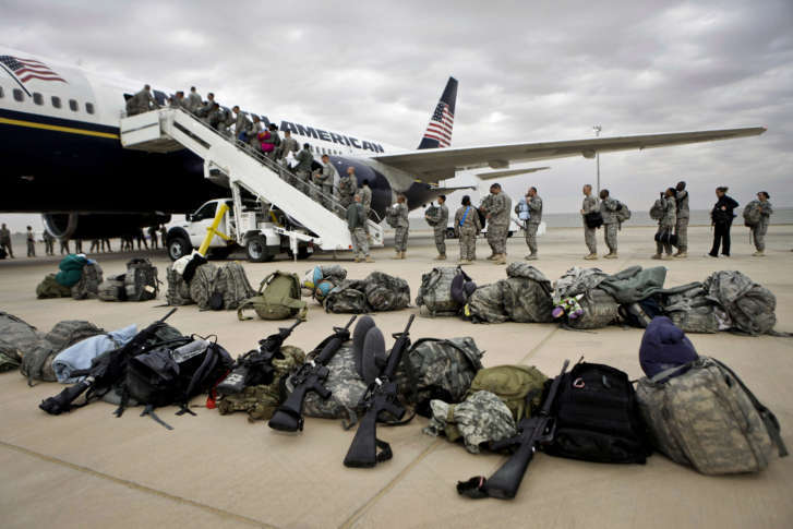 In this Tuesday Nov. 1  2011 file photo U.S. soldiers begin their journey home at al-Asad airbase west of Baghdad Iraq. The Triple Canopy settlement ... & Reston contractor Triple Canopy to pay $2.6M to settle false ...