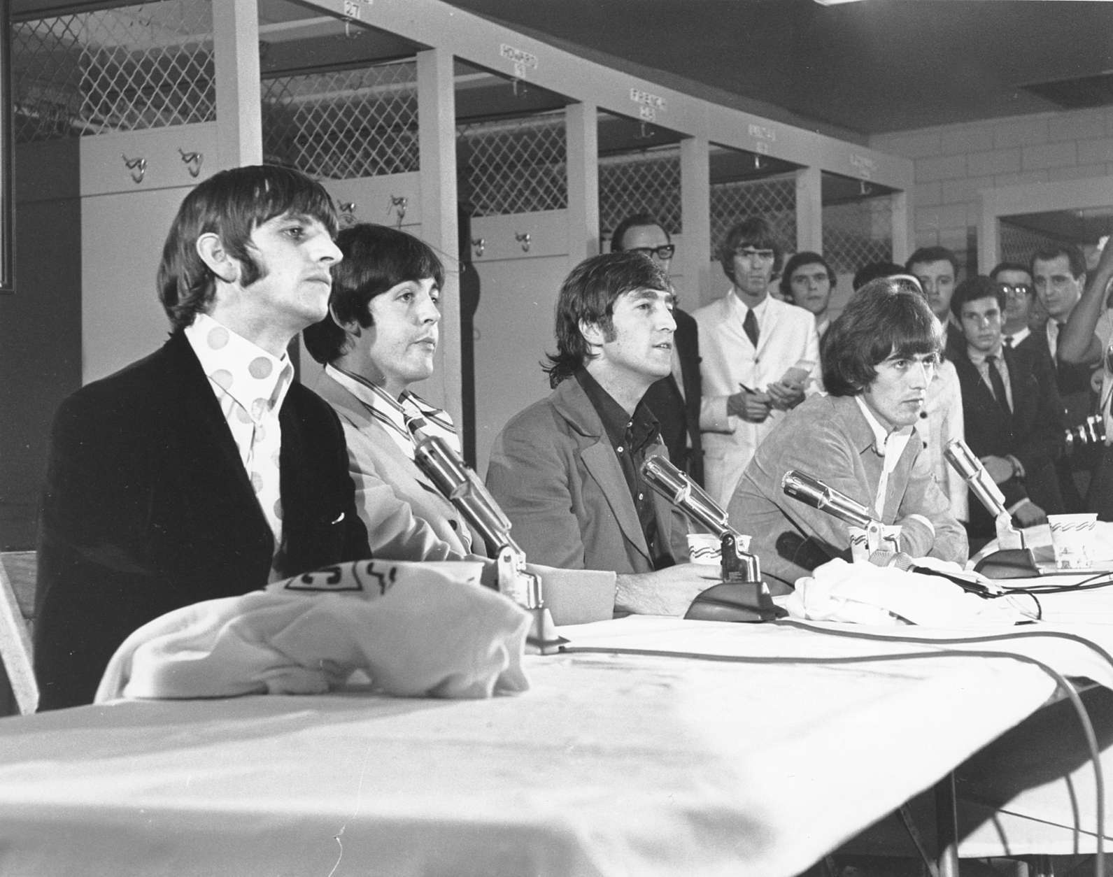 The British pop group, The Beatles, are seen holding a news conference at the District of Columbia stadium in Washington before their concert on Aug. 15, 1966.  Pictured, from left to right, are: Ringo Starr, Paul McCartney, John Lennon and George Harrison. (AP Photo/Harvey Georges)