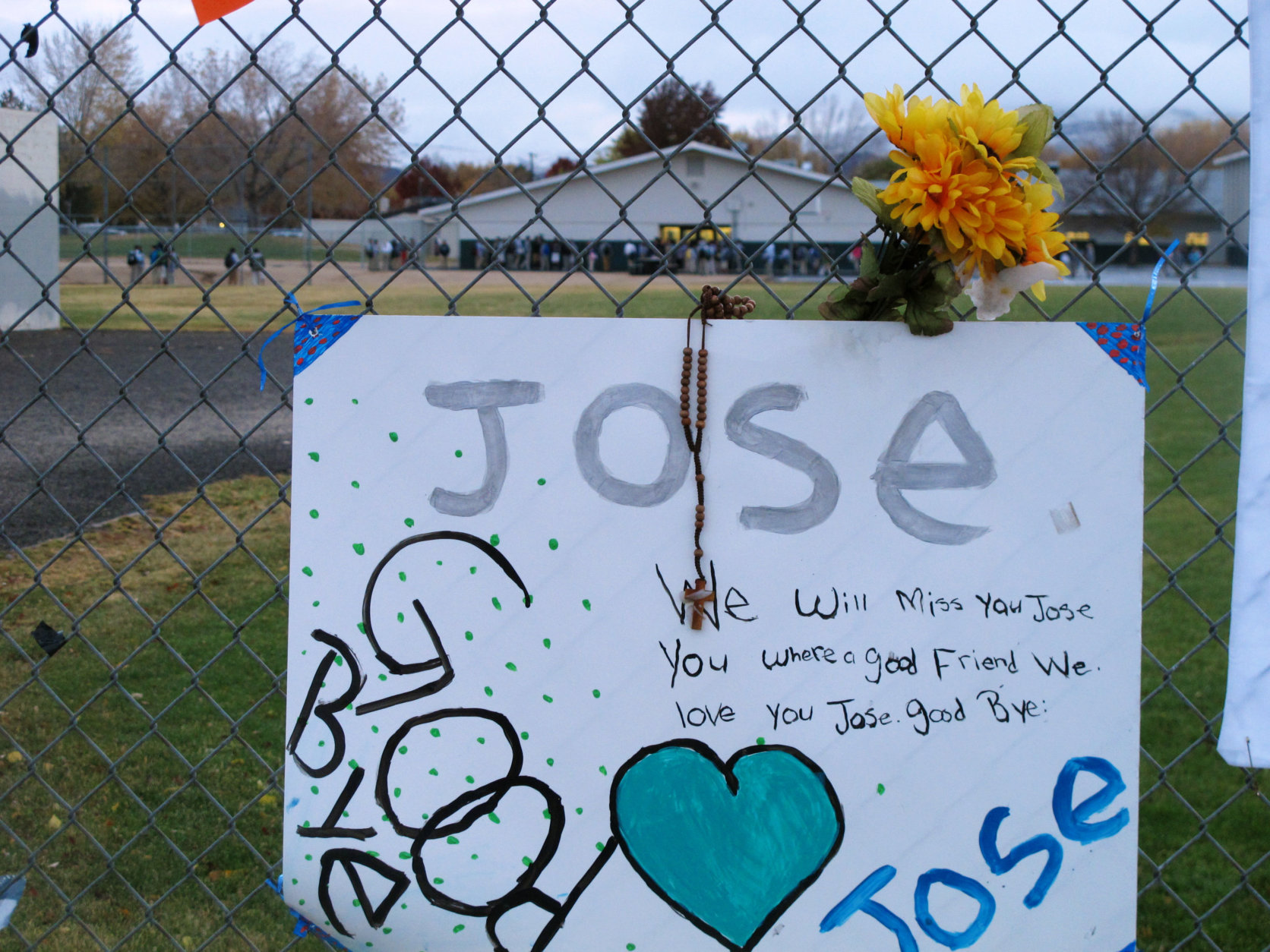 Students return to Sparks Middle School on Monday morning, Oct. 28, 2013, for the first time since Oct. 21, when a 12-year-old student gunned down a teacher and wounded two classmates before killing himself. Friends added a rememberence of the shooter, Jose Reyes, at a makeshift memorial also honoring the fallen math teacher and ex-Marine Michael Landsberry. Police don't know why seventh grader Jose Reyes killed 45-year-old Michael Landsberry and shot two 12-year-old boys before turning the handgun on himself. AP Photo/Scott Sonner)