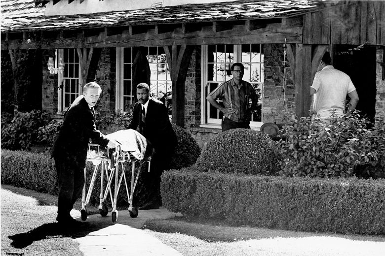 The body of actress Sharon Tate is taken from her rented house on Cielo Drive in Beverly Hills, Calif., on Aug. 9, 1969.  Tate, who was eight months pregnant, and four other persons were found murdered by American cult-leader Charles Manson and his followers. Tate, the wife of director Roman Polanski, was born in 1943.  (AP Photo)