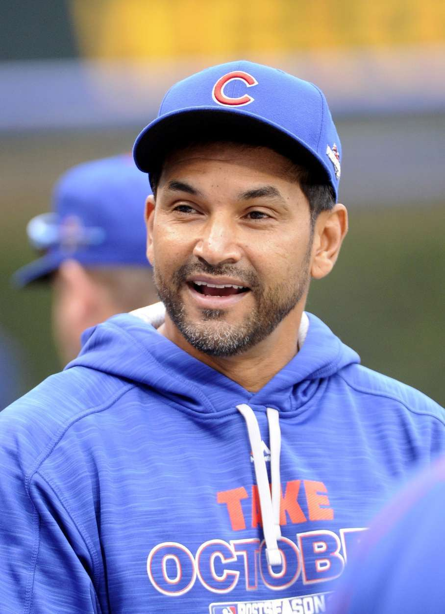 Chicago Cubs bench coach Dave Martinez during a workout in preparation for Game 1 of baseball's NL Championship Series in Chicago, Thursday, Oct. 15, 2015. (AP Photo/David Banks)