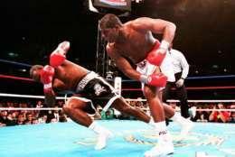 Heavyweight champion Riddick Bowe knocks down Jesse Ferguson during the WBA and IBF championship fight, May 22, 1993. (AP Photo/Marc Wilson)