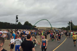 The first of 35,000 runners gather near the starting line for the start of the Army 10 Miler. (WTOP/John Domen)