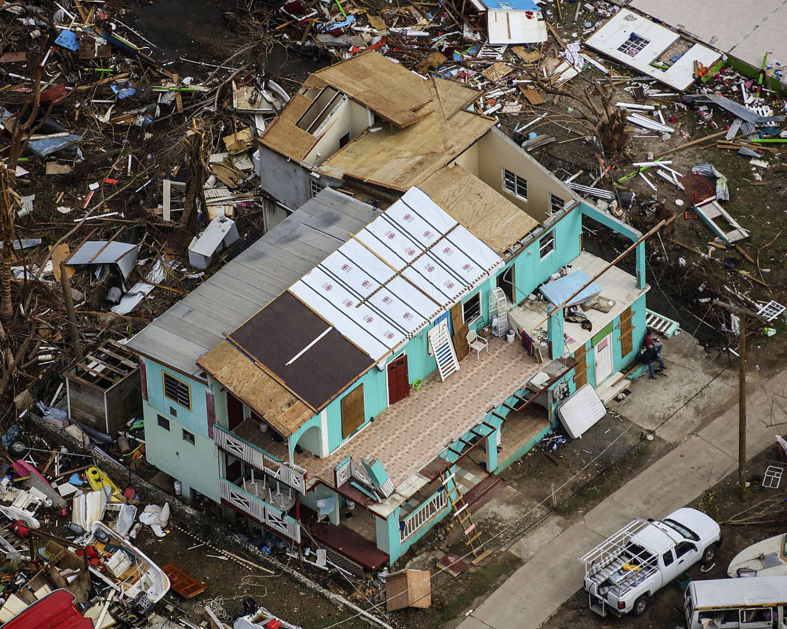 This photo provided by the Royal Navy and taken on Sunday, Sept. 24, 2017 shows the devastation left by Hurricane Irma in Jost Van Dyke, British Virgin Islands. Irma, once the most powerful hurricane ever recorded in the open Atlantic, wreaked havoc in parts of the Caribbean — Antigua and Barbuda, Anguilla and St. Martin, the U.S. and British Virgin Islands, Turks and Caicos, the Bahamas and parts of Cuba — leaving more than three dozen people dead and turning vacation island paradises into devastated landscapes. (Joel Rouse/Royal Navy via AP)