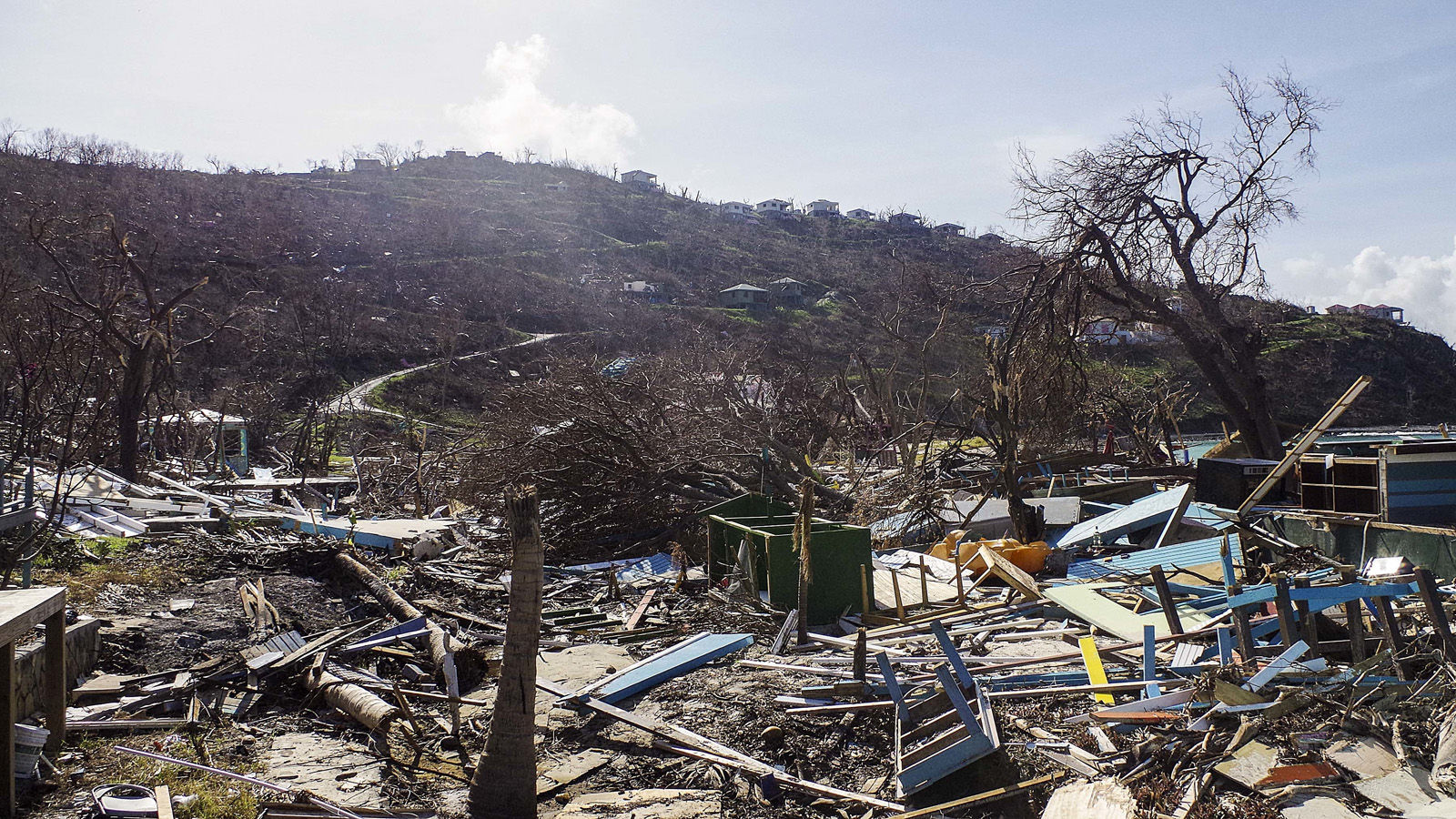 This photo provided by the Royal Navy and taken on Sunday, Sept. 24, 2017 shows the devastation left by Hurricane Irma in Great Harbour, British Virgin Islands. Irma, once the most powerful hurricane ever recorded in the open Atlantic, wreaked havoc in parts of the Caribbean — Antigua and Barbuda, Anguilla and St. Martin, the U.S. and British Virgin Islands, Turks and Caicos, the Bahamas and parts of Cuba — leaving more than three dozen people dead and turning vacation island paradises into devastated landscapes. (Dan Lauder/Royal Navy via AP)