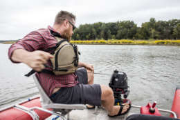 Terrain 360 founder Ryan Abrahamsen rips the pull cord to start the motor, Tuesday Sept. 26, 2017, in Upper Marlboro, Maryland. Abrahamsen is mapping the Patuxent River, in partnership with the Chesapeake Conservancy, to create virtual river tours. (Alex Mann/Capital News Service)