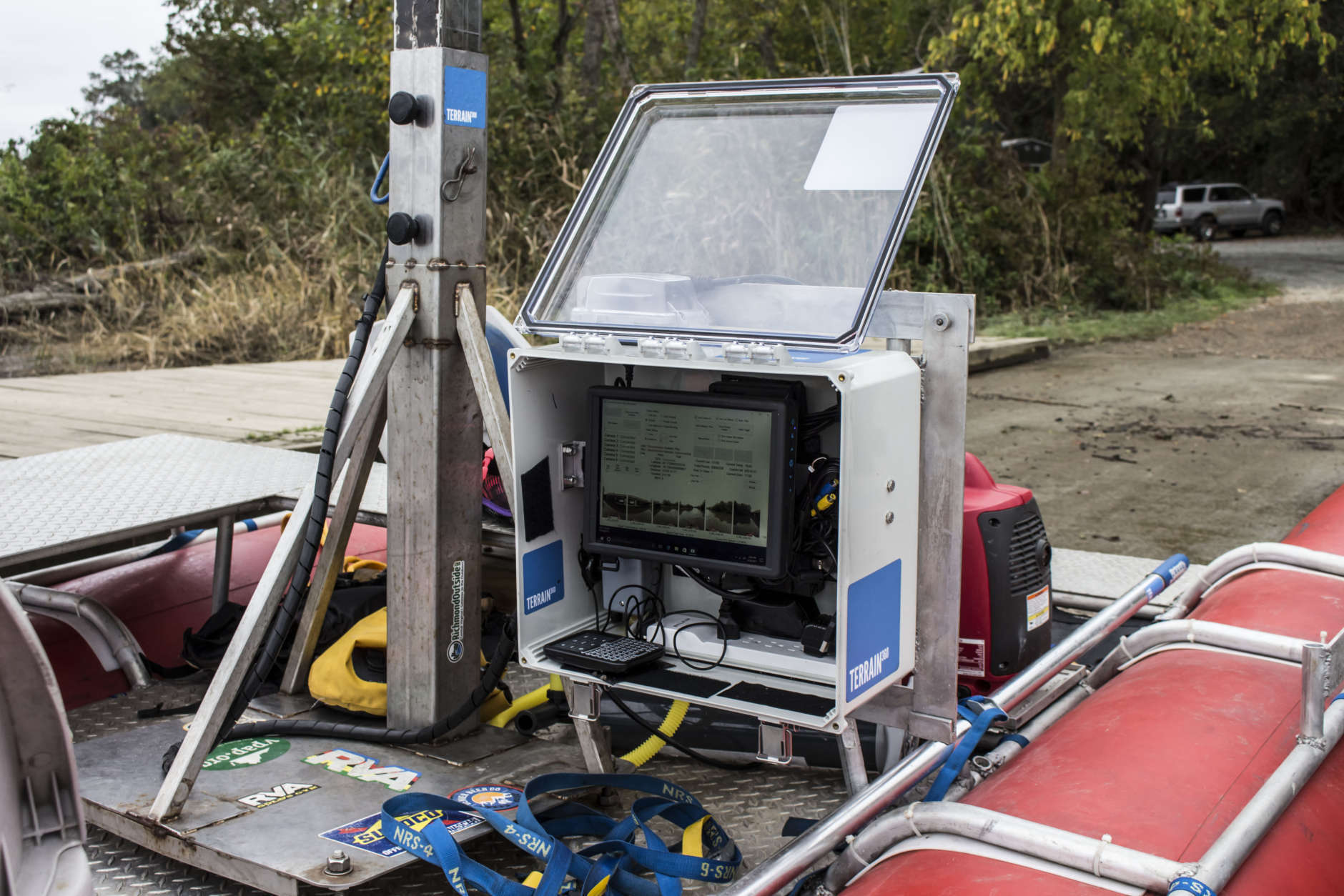 Ryan Abrahamsen designed a computer that coordinates GPS and synchronizes six Canon cameras to shoot 360 photos every 40 feet on the water. Terrain 360 was mapping the Patuxent River, launching from Upper Marlboro, Maryland, in partnership with the Chesapeake Conservancy, to create virtual river tours Tuesday Sept. 26, 2017. (Alex Mann/Capital News Service)