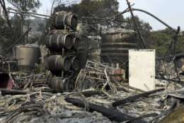 Damage to wine making vats and barrels at the production house of Paradise Ridge Winery from a wildfire are seen on Tuesday, Oct. 10, 2017 in Santa Rosa, Calif. An onslaught of wildfires across a wide swath of Northern California broke out almost simultaneously then grew exponentially, swallowing up properties from wineries to trailer parks and tearing through both tiny rural towns and urban subdivisions. (AP Photo/Ben Margot)