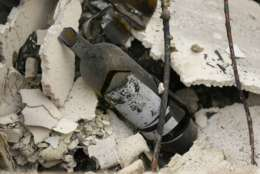 The remains of a burned bottle of wine are seen at the Signorello Estate winery Tuesday, Oct. 10, 2017, in Napa, Calif. Worried California vintners surveyed the damage to their vineyards and wineries Tuesday after wildfires swept through several counties whose famous names have become synonymous with fine food and drink. (AP Photo/Eric Risberg)