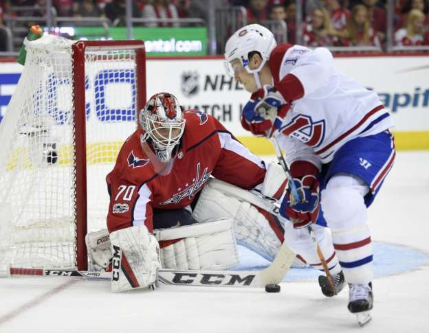 adfb3966581 Canadiens Capitals Hockey 12233 Washington Capitals goalie Braden Holtby  (70) stops the puck against Montreal Canadiens right wing Brendan Gallagher  (11) ...