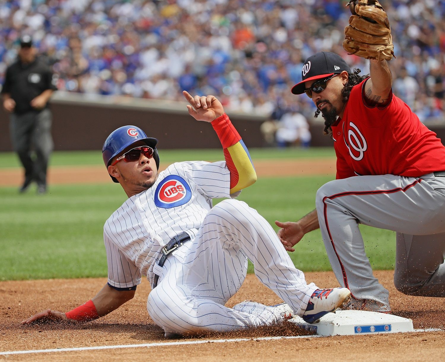 CHICAGO, IL - AUGUST 05:   Willson Contreras #40 of the Chicago Cubs is tagged out at third base by Anthony Rendon #6 of the Washington Nationals in the 1st inning at Wrigley Field on August 5, 2017 in Chicago, Illinois. (Photo by Jonathan Daniel/Getty Images)
