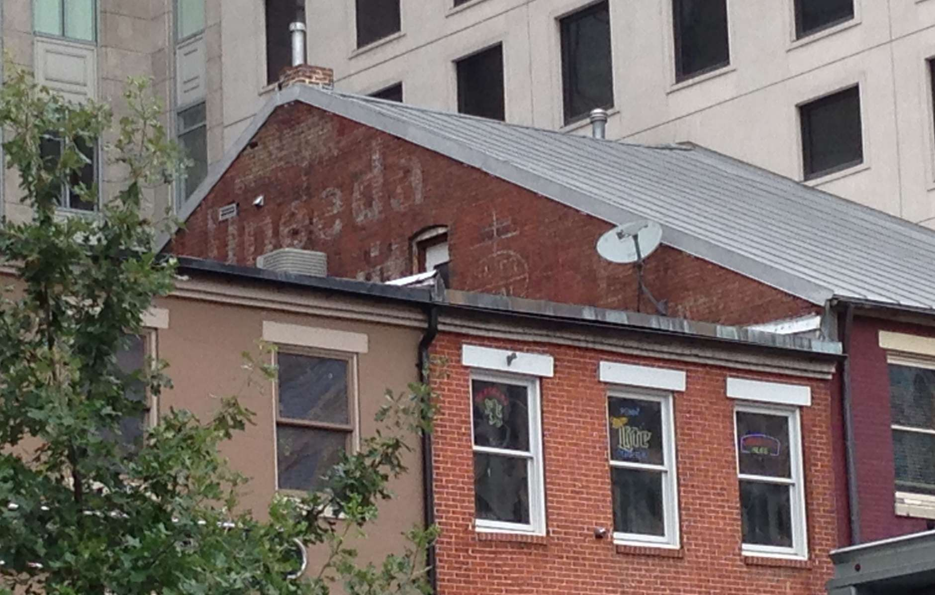 """Advertising for Uneeda Biscuit (aka """"The Nation's Soda Cracker"""") is found twice on this haunting tour. The first is at 637 Indiana Ave. NW. (D.C. Historic Preservation Office/Kim Williams)"""