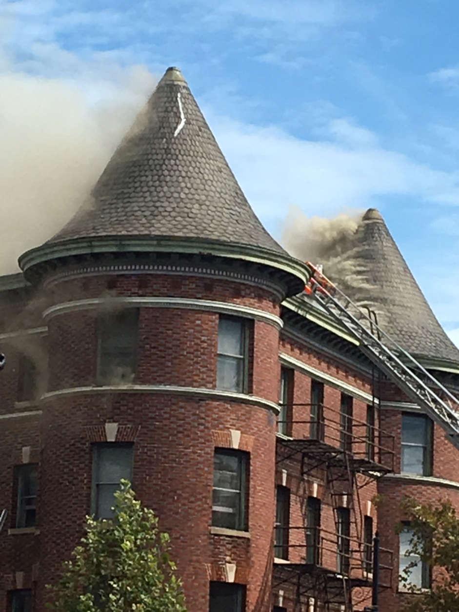 An apartment building burns at Vermont Avenue and Q Street in Northwest D.C. (WTOP/Lisa Weiner)