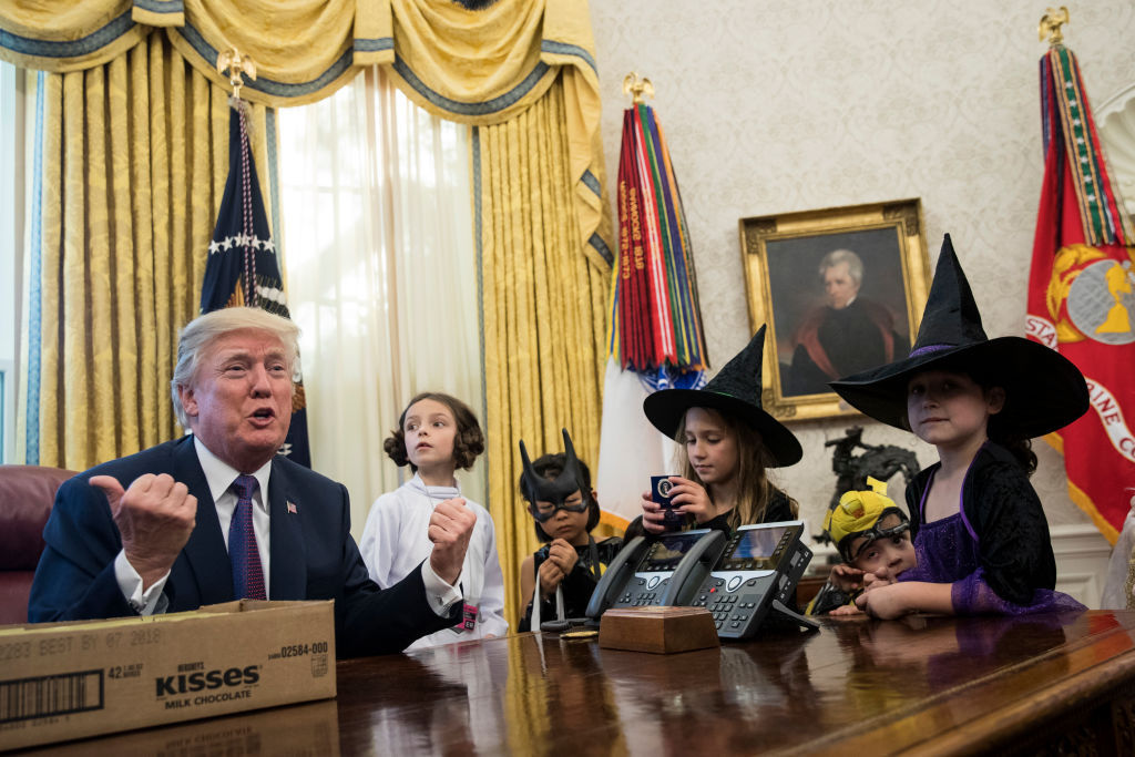 WASHINGTON, DC - OCTOBER 27: U.S. President Donald Trump meets with children of journalists and White House staffers in the Oval Office at the White House, October 27, 2017 in Washington, DC. The children were dressed in costume for Halloween.  (Drew Angerer/Getty Images)